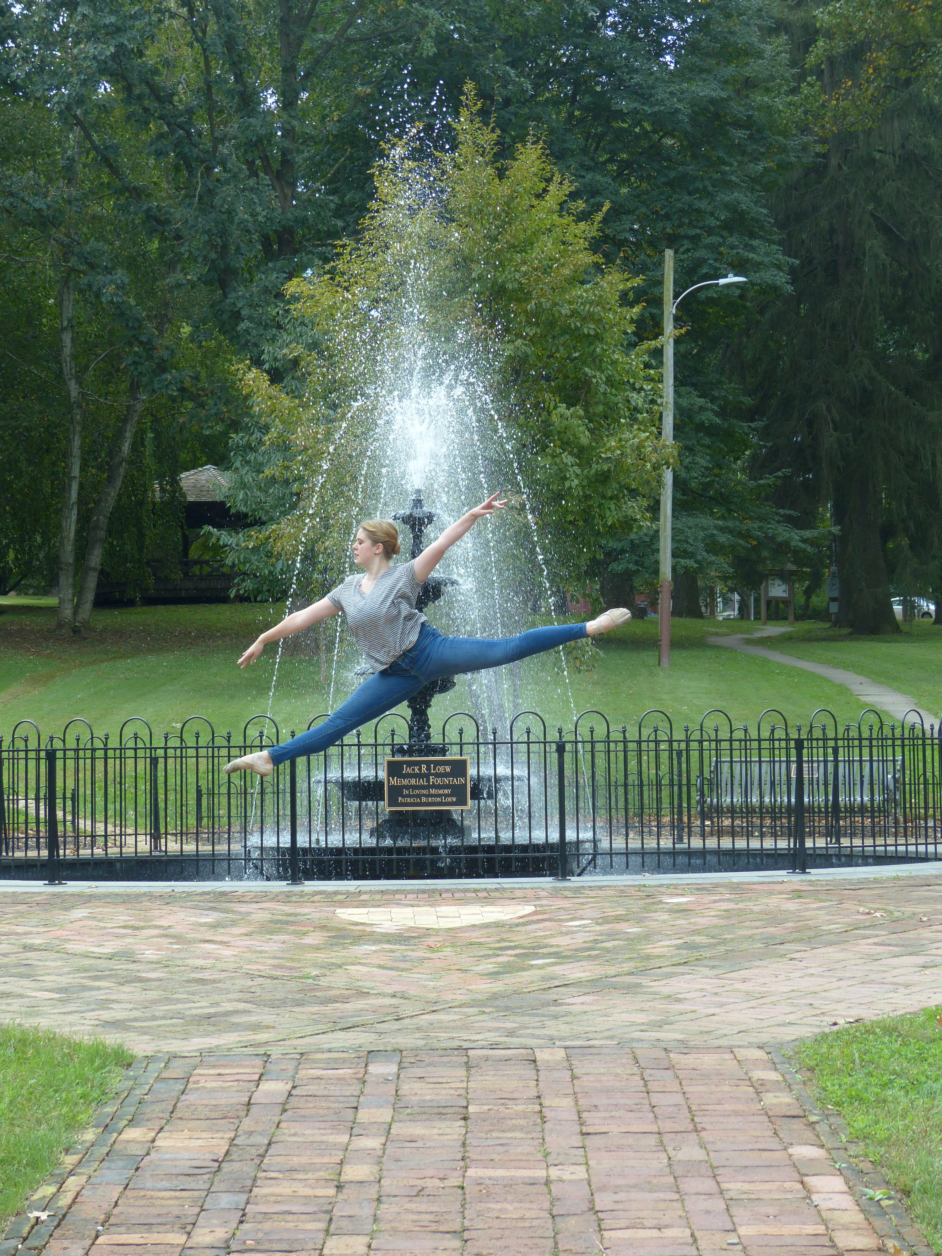 dancer jumping at fountain